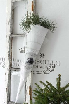 """Long white cone wrapped in organza and lace, filled with evergreen sprigs and hanging from a pretty ribbon. (and """"fresh! French Christmas, Cozy Christmas, White Christmas, Vintage Christmas, Xmas, Christmas Ideas, Christmas Centerpieces, Christmas Decorations, Christmas Ornaments"""