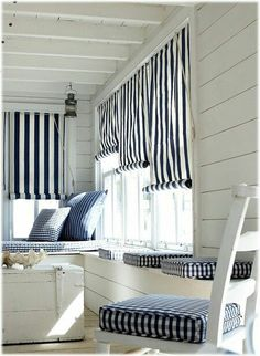 Mixed Gingham And Striped Decor Brighten this Closed in Coastal Cottage Porch !