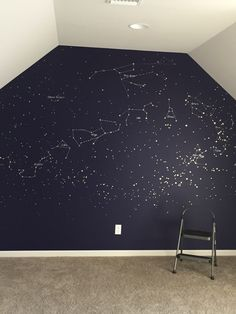 Constellation map mural. Painted with gold and silver paint pens in a deep blue wall.
