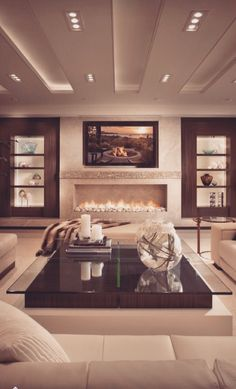 This is definitely a cozy living space. The naturalistic design and fireplace make the room comfortable and calming. The warm colours give a cozy, togetherness feel.