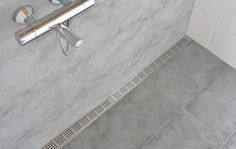 Bathroom with a costumised modular line floor drain system. Elegant grating and frame in brushed stainless steel. Floor Drains, Basement Flooring, Nordic Design, Brushed Stainless Steel, Tile Floor, Minimalist, Inspirational, Shower, Bathroom