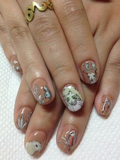 How on earth do you get those bunnies on your nails?? What's the trick beside practise? Or is it a sticker?