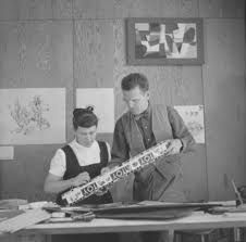 Charles and Ray Eames reviewing a production example of The Eames Toy made by Tigrett #eames #tigrett  A Ray Eames painting hangs on the wall above Charles' head.