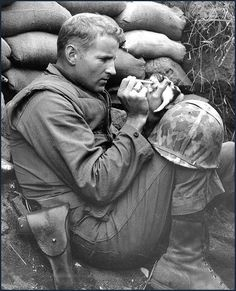 a marine feeding a kitten