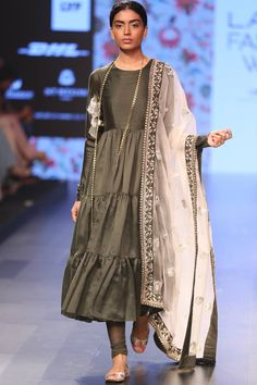 Payal Singhal presents Tiered anarkali and churidar with organza dupatta.