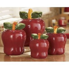 Kitchen interior ideas with apple kitchen accessories. Love working in the kitchen? Make this space even better with delightful kitchen decor pieces like ceramic canisters, funny chef figurines and wine holders. Apple Kitchen Decor, Kitchen Decor Themes, Red Kitchen, Home Decor, Kitchen Ideas, Kitchen Layout, Decorating Kitchen, Kitchen Stuff, Kitchen Interior