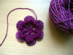 Crochet flowers are fast, easy, and perfect for embellishing almost anything. Learn how to make a basic two-layer flower with this step-by-step tutorial.