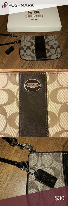 "COACH Signature C pattern wristlet Coach wristlet in the classic jacquard pattern. Satin lined with brown leather strap, piping, and logo tag. Features silver hardware,  measures 6"" x 4.5"" and comes boxed. In excellent condition! Price is firm. Coach Bags Clutches & Wristlets"