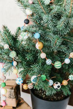 DIY wood bead garland - The House That Lars Built Bead Garland Christmas Tree, Wood Bead Garland, Diy Christmas Tree, Beaded Garland, Christmas Decorations, Christmas Ornaments, Holiday Decorating, Christmas Snowman, Xmas