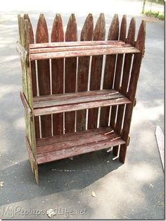Old picket fence upcycled into garden shelf