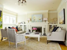 Love the glass fronted built-ins flanking the fireplace. Painting looks great too. (House of Turquoise: Graciela Rutkowski Interiors)