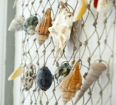 Make a wall hanging with collected shells! http://www.completely-coastal.com/2015/05/sea-shell-wall-hanging.html