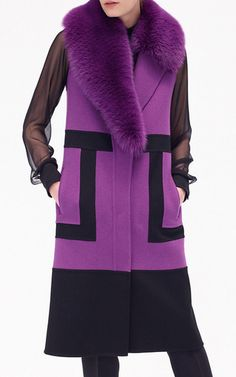 This **J. Mendel** vest is rendered in double faced wool cashmere with a contrasting graphic design and features an asymmetrical shadow fox collar, a relaxed silhouette with dual welt pockets, and a midi length hem.