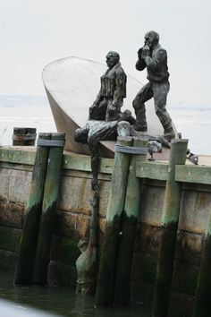 Located on the west side of Battery Park, the American Merchant Mariners' Memorial is a haunting tribute to commercial seamen who lost their lives, for whatever reason, on the water. The memorial, was based on a true event during World War II, in which a Nazi U-boat attacked an American merchant marine vessel. While the marines held on to their sinking vessel, the Nazis photographed the victims, then left. The memorial is directly inspired by one of those photographs. Very moving.