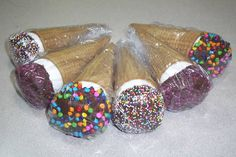 Jumbo marshmallows dipped in chocolate, candies/sprinkles and placed in a sugar cone.