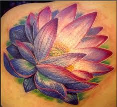 Love the colours of this lotus tattoo!