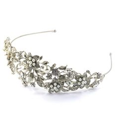 A breathtakingly beautiful headband tiara with pretty crystal flowers, silver leaf detail and pearls  A balanced mix of sparkly crystal rhinestones, diamantes and pearls help to make this one of most treasured headband tiaras