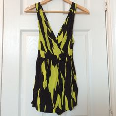 Neon romper Funky, unique neon and black romper. Low cut in front and back and short. Pockets on the sides. Zips on the side Wet Seal Dresses