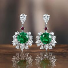 Framed by 28 sparkling diamonds, the two fascinating Colombian emeralds set in these earrings of the House of Gübelin's Ornament of Flowers line are at the heart of these fine jewellery pieces.