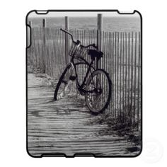 'BIKE WITH FENCE' iPAD CASE, by The Flying Pig Gallery on Zazzle (lizadeyphoto) - iPad case featuring a black & white image of a bike leaning up against a dune fence. Photographed on Fire Island, NY.