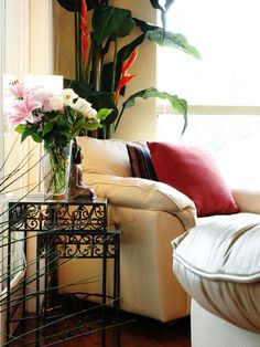 Classic Red - Designer Elizabeth P. Clarke uses a crisp red pillow against a cream chair for a splash of color.