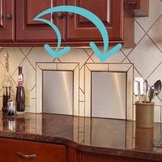 Small sliding doors in the kitchen to the trash and recycle bins.