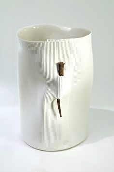 White ceramic vessel plus nail pin clay art pottery artist Hilary Mayo | Nail Vessel Photo: Geoff Crawford