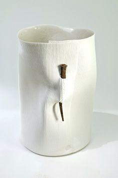 White ceramic vessel plus nail pin clay art pottery artist Hilary Mayo | Nail Vessel Photo: Geoff Crawford