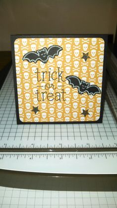 This was made using We R Memory Keepers Bewitched paper, the Lawn Fawn Trick or Treat stamp set, and the little star stamp from the Stampin' Up! Banner Blast set!