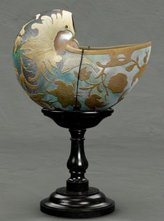 I present my latest work The Nautilus Cup.Inspired from an image I saw on the web.I liked the idea of carving away the outer shell to reveal the mother of pearl beneath
