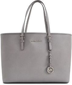 a7aa72fcc456 Michael Kors Jet Set Travel Multifonction MD Tote on shopstyle.co.uk