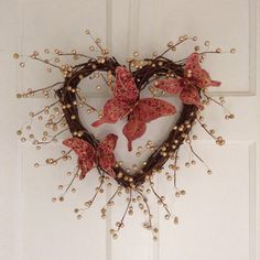 Valentine's Day Red Butterfly Heart Shaped Grapevine Wreath. Decorated with 3 ornate gem encrusted butterflies and gold berry garland. 12 in