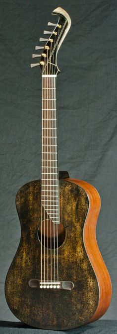 Matsuda Mini custom (parlor size).    - Italian spruce top, scorched.  - Cambodian rose wood sides and back.  - Mahogany neck. (stained black. Maple at head stock is inlayed in Mahogany).  - Wenge Fingerboard, bridge.  - Gotoh stealth tuner, and hand made buttons