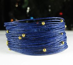 Wikkitz Bracelet in Midnight Blue with Gold Beads. $25.00, via Etsy.