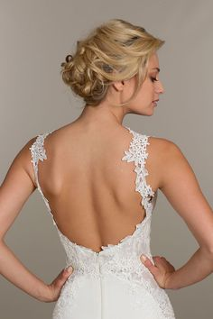 Ivory lace and crepe trumpet bridal gown.