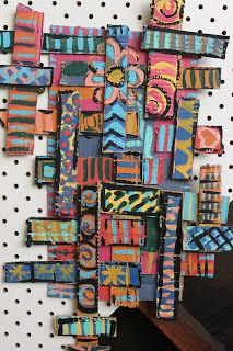 Cardboard relief collaborative sculptures: first strips of different widths and lengths were layered, then acrylic designs were added, passing the colors around and adding more layers of color and design, saving black for last.