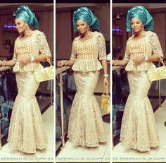 Gold lace top and mermaid skirt with Blue Gele. Nigerian fashion.