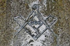 """Stone engraving in Vatican City with the 666 (ANTICHRIST) numerals within a Freemason Compass & Square. Just showing that their Masonic god is (LUCIFER/LIGHT BEARER). Walt Disney was a 33 Degree Freemason. Again that's why Walt Disney promotes Satanism in (EVERYTHING) he & his company has ever created.  (Revelation 13:18) """"Here is wisdom. Let him who has understanding calculate the number of the Beast (ANTICHRIST/SATAN), for it is the number of a man: His number is (666)"""