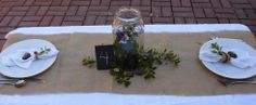 DR Ideas:  Table with Pickle Jar centerpiece with small plant inside.  Burlap table runner.