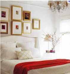 Really liking the gold frames with all the white. (And the HEADBOARD!)