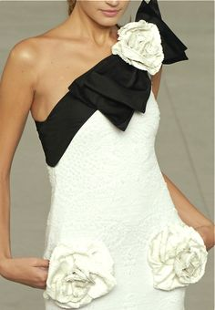 Chanel---Chanel---Lovely black and white gown with rosettes and a sweet bow…tres chic!