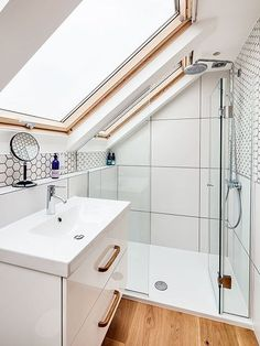 A beautiful example of a small bathroom space. The skylight lets plenty of natural light flood in which helps the space to feel larger and lighter. best bedroom decor Small bathroom in need of clever tricks? Browse our small bathroom design ideas. Small Attic Bathroom, Loft Bathroom, Upstairs Bathrooms, Bathroom Design Small, Bathroom Ideas, Sloped Ceiling Bathroom, Bath Design, Bathroom Ceilings, Attic Shower