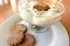 Rhubarb and ginger syllabub with ginger biscuits