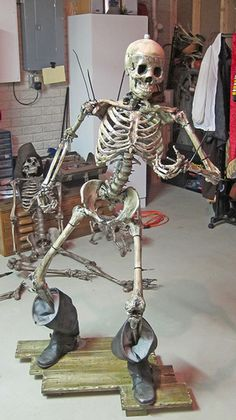 We started by determining the location for floor flanges and began supporting the lower legs by using conduit to mimic the pose, attaching it to the back of bones with zip-ties. (Keeping mind to hide as much to the conduit as possible). Some blending of the conduit was needed with the use of a conduit bender to fit the pose. Once the legs where stable, we worked our way up the skeleton following the same procedures. As we reached the tail bone, a tee compression fitting was used to j