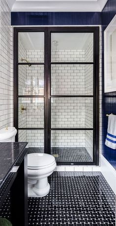 White subway tiles in navy and white bathroom. This is my dream bathroom renovation. House Bathroom, Home, White Subway Tiles, Shower Doors, Bathrooms Remodel, Bathroom Decor, Beautiful Bathrooms, Bathroom Renovation, Bathroom Inspiration