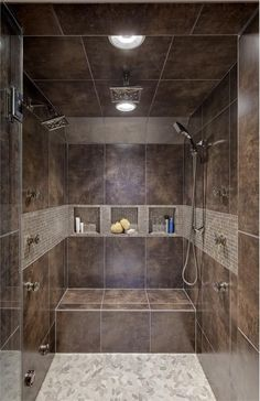 Fabulous contemporary bathroom wall cutout features walk-in shower with brown mosaic tile shower and spa-like bath design, oversized shower. Bathroom transitional master bath design decoratively rock shower floor and rain shower head and bath design chi