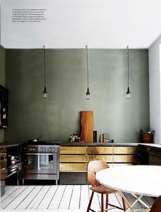 raw grey walls and gold cabinets // via coco kelley