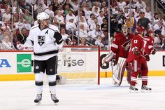GLENDALE, AZ - MAY 22: Anze Kopitar #11 of the Los Angeles Kings celebrates after tipping in a shorthanded goal in the first period on a shot by teammate Drew Doughty #8 past goaltender Mike Smith #41 of the Phoenix Coyotes in Game Five of the Western Conference Final during the 2012 NHL Stanley Cup Playoffs at Jobing.com Arena on May 22, 2012 in Phoenix, Arizona. (Photo by Christian Petersen/Getty Images)