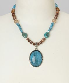 When a day calls for a dash of panache, pick up this boho-chic necklace! Boasting a colorful pendant and beads with earthy hues, it's a beautiful way to bring easy-breezy style into ensembles.