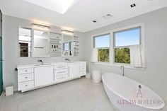 Sleek and modern bathroom design.  Less is more! Alexim Builders, Southampton, New York